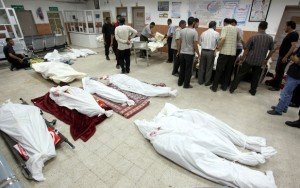 Bodies of Palestinians killed in an Israeli air strike on the floor of a hospital in Khan Younis, Gaza, earlier today. (Ramadan El-Agha / APA images)